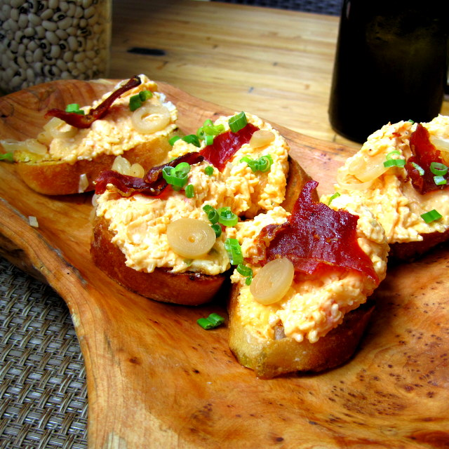 Grilled crostini with cheddar pimento, pickled ramps, and crispy country ham