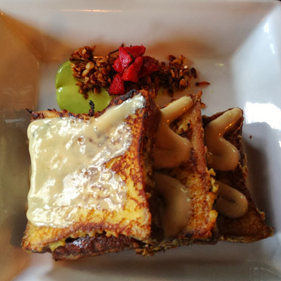 Brioche french toast with foie gras frosting, pistachio custard, macerated strawberry, and candied granola