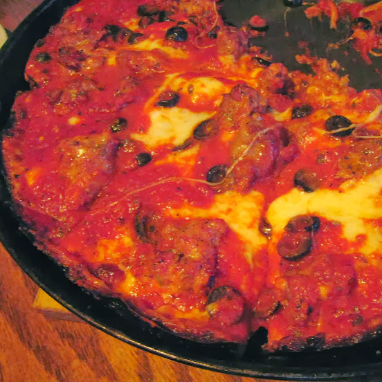 Pequod's deep-dish pizza with sausage and black olive