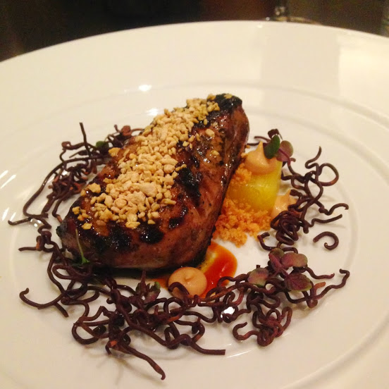 Miso-cured and grilled foie gras with pineapple, chocolate, almond cookie, unagi, and malt
