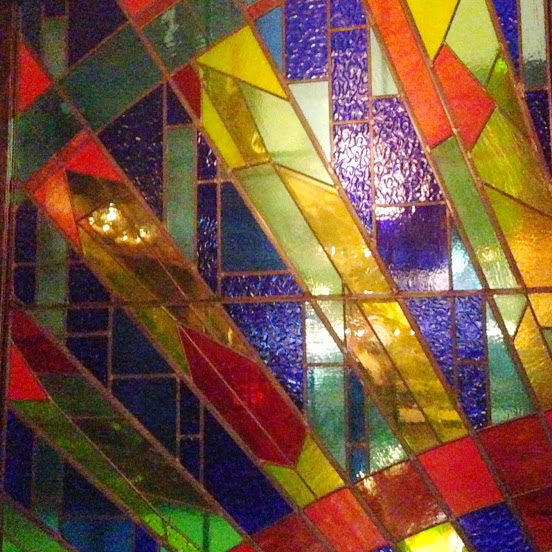 Stained glass window enclosing our table