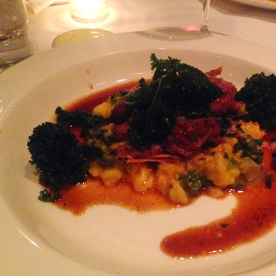 "Braised pork shank ""off the bone"" and carnaroli risotto with squash, caramelized onions, and wilted kale"