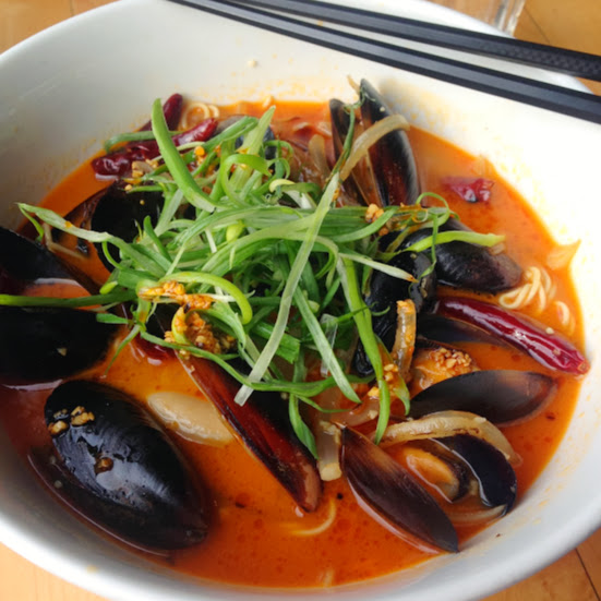 Musclemen ramen with mussels, onion, chili pepper, scallion, and bonito miso