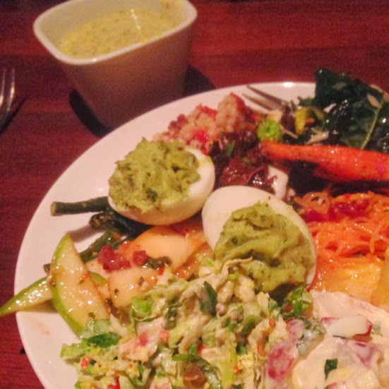 Brussels sprout caesar salad, guacamole deviled eggs, spicy Thai apple and carrot salads, sauteed wild mushrooms, and more bounty from the harvest table