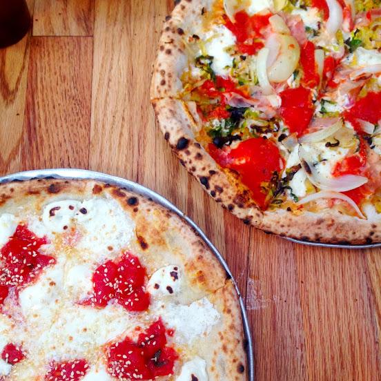 Four Emperors (arrabbiata, mozzarella, ricotta, capra con pepe, asiago, and sesame seed) and Lionheart (tomato, mozzarella, pecorino, prosciutto cotto, brussels sprouts, and onion) pizzas, Roberta's