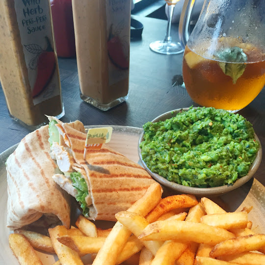 Chicken breast wrap with macho peas and fries, Nando's Peri Peri