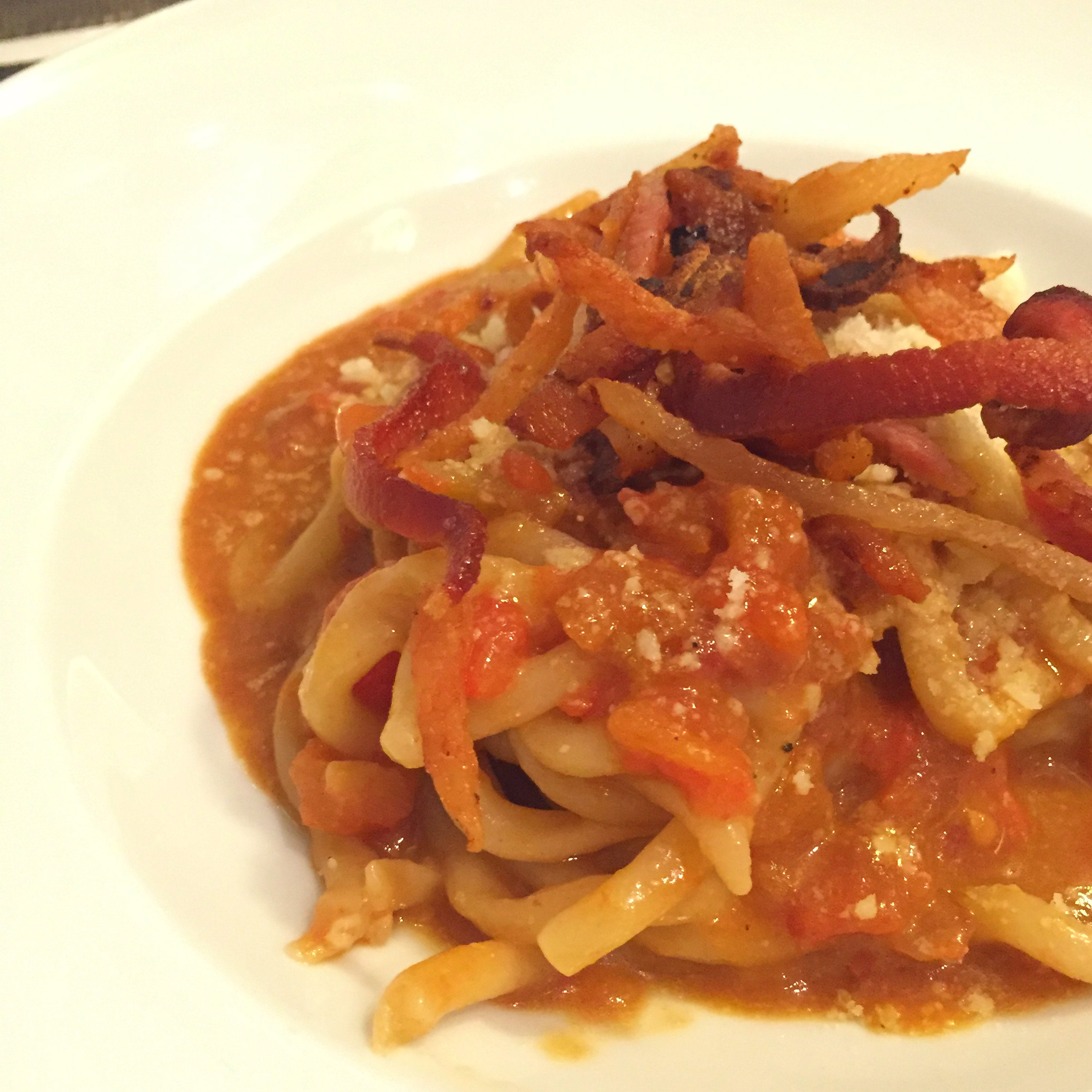 Strozzapreti with tomatoes, parmesan, pecorino, and bacon, Sofia