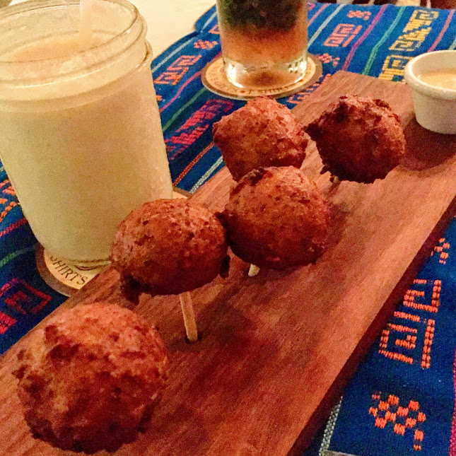 Conch fritters and Crazy Monkey cocktail, Elvi's Kitchen