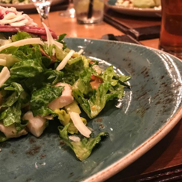 Pub chopped salad with grilled chicken, salami, shrimp, chickpeas, cherry tomatoes, white cheddar, pretzel crisp, and apple cider vinaigrette, Gordon Ramsay Pub & Grill