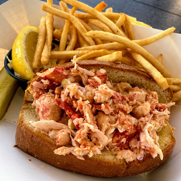 East Coast-style lobster roll on a split-top New England bun, Boathouse on the Bay